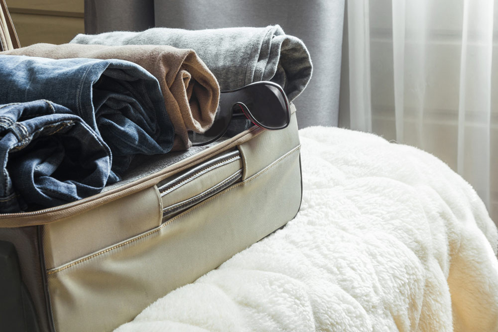 roll clothes in suitcase